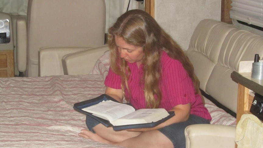 Athena Reads Bible to kids for evening Bible Study