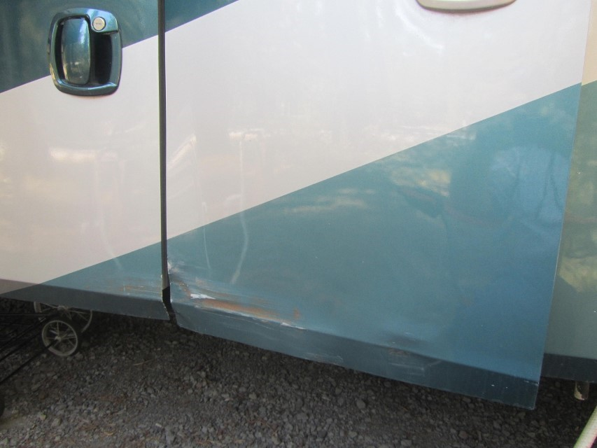 In Newport Oregon, we knocked over a fence post with the drivers side of the RV. We mostly straightened the door panel using a 1×6 on the painted side, and squishing the door against the board with a C clamp repeatedly. We did not want to heat the door rapid cool it for straitening, as a blow torch next to the propane tank sounds like not good fire safety.