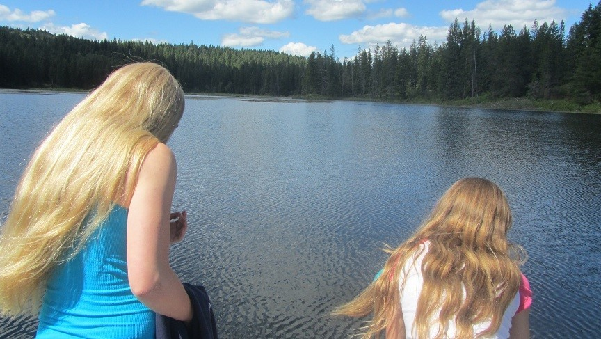 The girls and I made it to the end of the dock. We are staring at the lake, contemplating nothing.
