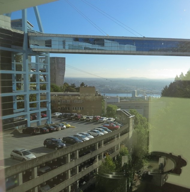 Eighty miles away in down town Portland. I am taking pictures out the window of Dornbecher Children's Hospital of the city and parking structures. Over the next month, we will be making a lot of trips here to get some of Holly's medical issues resolved. This is probably the best medical facility available to kids in Oregon.  Staying in a Thousand Trails Park while getting medical care such as this though, is not a good idea. If you have to be in the big city, and you need to stay late or arrive very early, and the Rangers during their patrols notice you are gone from your campsite, they will believe you were not in at all during the night.  All three coastal parks have a $32.00 per night fine for each night they believe you are gone. Some of the parks will also ask you to leave.  We as a result will be moving the RV to the Portland area for most of Holly's care.  Saves driving too.