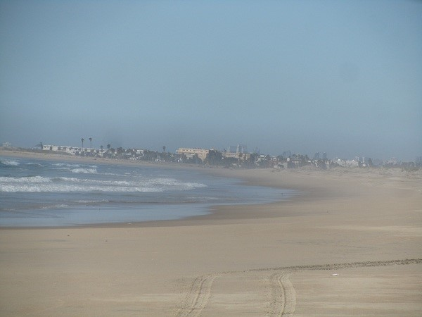 Looking north from the sewer pipe we see Imperial Beach where some of America best surfing used to be.