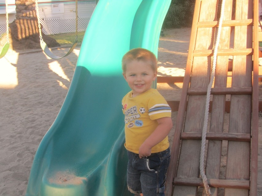 Alex- Steve and Shari Stone's son- is showing us the value of sunshine, toys and dirt. Kind of makes one miss being a kid.