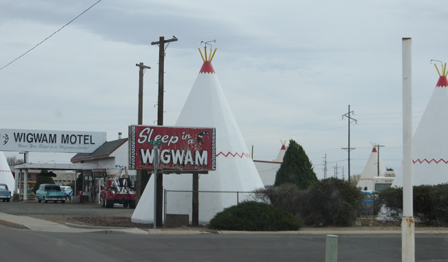 """Whoa! wait just one doggone minute! Isn't this the cozy cone hotel from Cars?   When you drive in front of this place, imagine the Tee Pee's  as pylons. The graphics artist in """"cars"""", did not miss a single detail."""