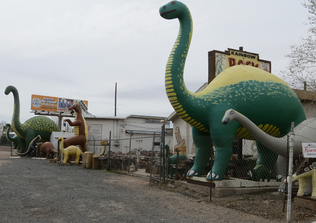 """I did not see these in """"cars"""", but they are everywhere along route 66.   The Dinosaur manufacturer must have been turning these out by the train load in 1950."""