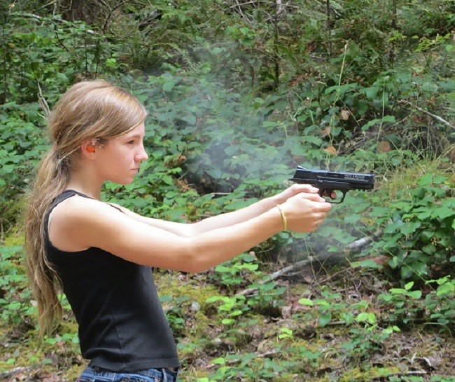 Sarah is giving the hand gun a try. She is pretty good