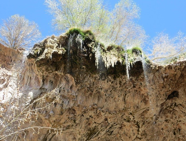 Water falling off the land above the cave.