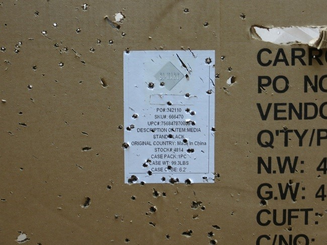 22 Caliber firearms make this box look like the front of our car after we towed it behind the RV on a freshly oiled road. Putting holes in the box was fun. Finding them in the front of our new car, was not. Lesson, less driving, more shooting with friends and family. Our thanks go out to the family members who took the time to show us the an empty forest service road in the Grande Rhone area. We really enjoyed our time together with you making a whole lot of noise in the woods.