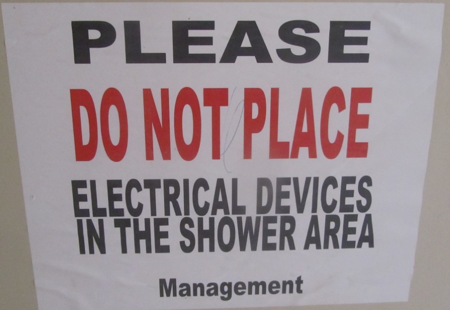 OK, this sign only entices me to do one thing. Drag my water Proof Boom Box into the shower room and crank rush Limbaugh until the manager arrives. I am not sure it would be the manager or the electricity that would be the great hazard to our health however.