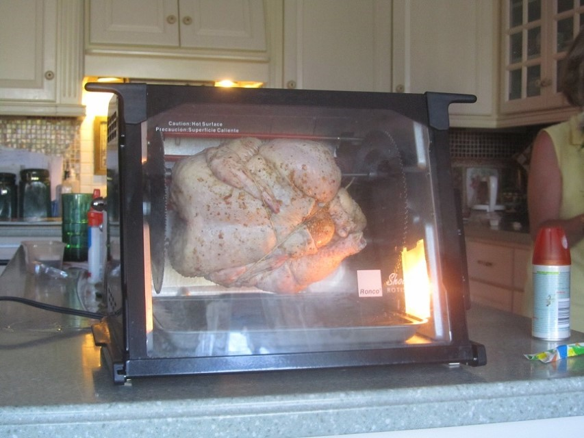 She got the chicken in the oven, now the hard work. We have to leave it in there until it is completely cooked.