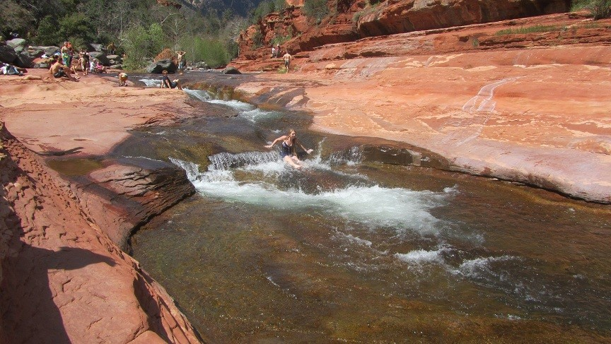 We arrive! Slide rock, is a sand stone slope with swift water to jump into.