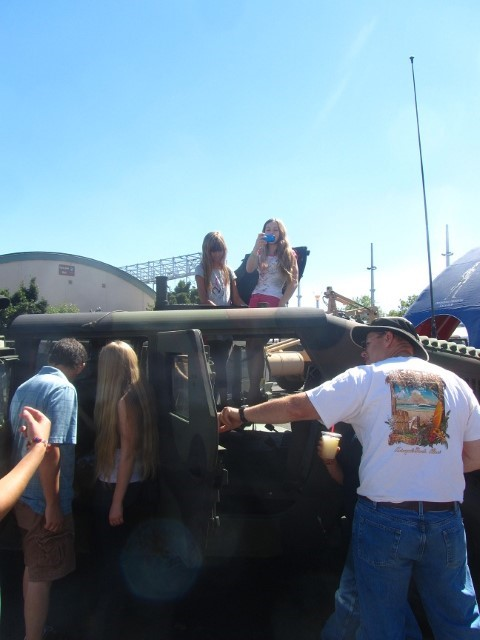 Mike Shows the girls around this army vehicle. One mistake he made though, is showing Holly where the ignition switch is, and how to use it.