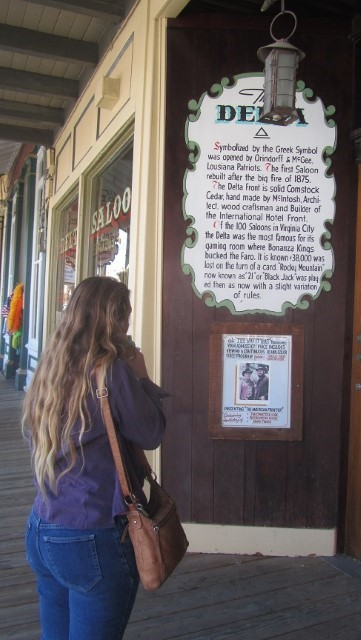 Athena is reading a sign about something that made no sense to me, so I just take pictures of her. (By the way, if you can't walk well don't go to Virgina city, the boardwalks are so bad, it is like walking in a fun house. Athena and Holly practically carried me around town. That was a sight!)