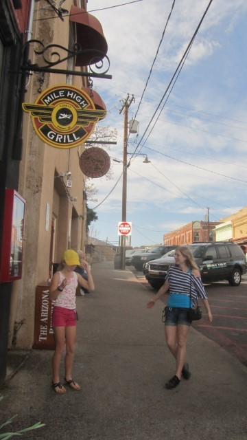"""Some fool told us that Denver was the Mile High City, and some crazy Fools bought that. Here we are with proof that Jerome Arizona is the mile high city, and we are standing out side the """"Mile High Grill"""" - we did not try food, one never know if it taste good at such an altitude."""