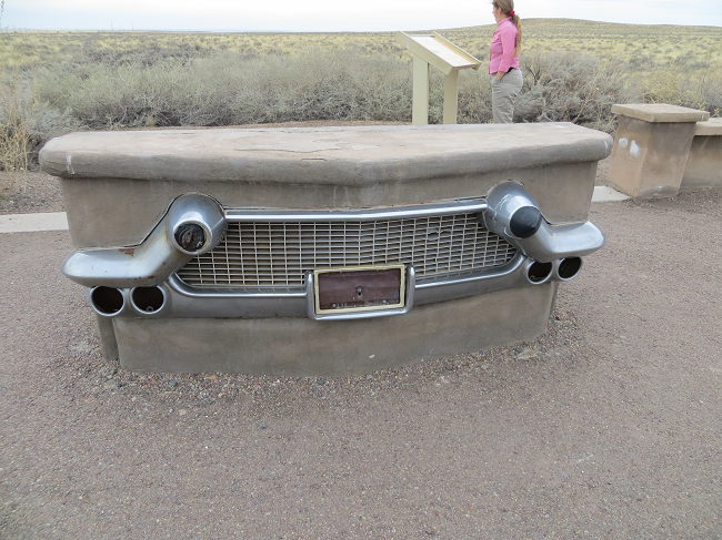 found a fossilized car!  On the other side is a bench that the wind and the rain carved out over time. I needed a bench, evolution is so good to me.