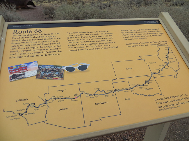 This sign and the car parts I listed above are found in the Petrified forest national park. This monument to the old route 66 where one would have turned into the national park.