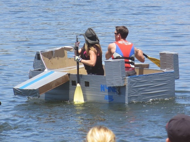 At the fair, they have a card board boat race.
