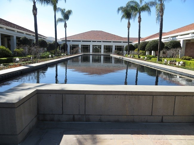 We are outside in the center of the complex looking at the reflecting pond.
