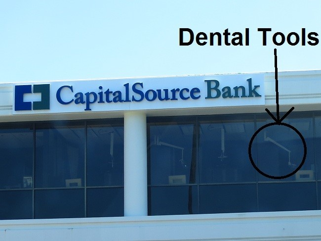 We found a bank. This is where they extract payment from those who have run out of money.  Who knew that fillings could be used as collateral?