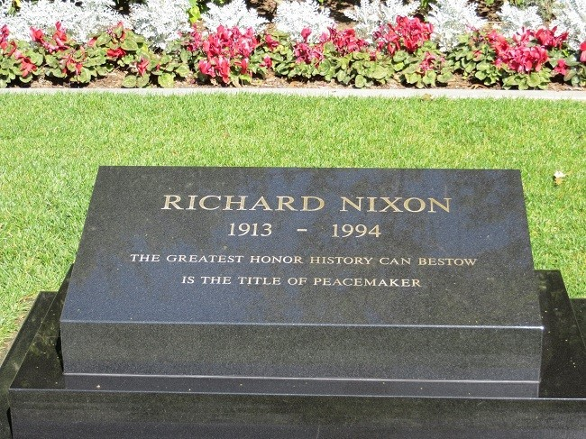 """Richard Nixon's Head stone . The gave him the title of  """"Peace Maker"""" I wonder why they took that from Colt. Who or what did Nixon win to get that title?"""
