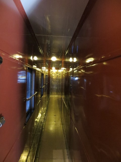 This a hallway leading to a 1937 era Dining car. This was considered the plush car of the Hollywood élite. To me it looks WWI submarine in pink.