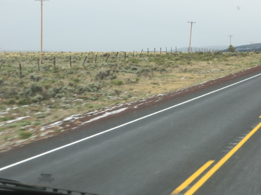 Spots of snow on the road