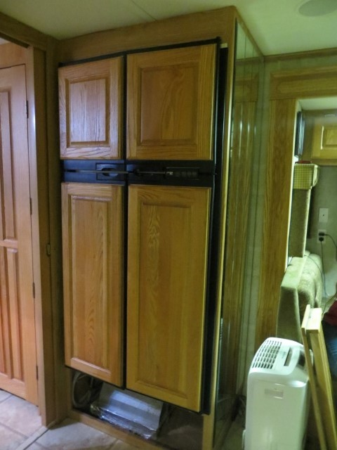 Norcold used to make a nice fridge, which rivals the Sub Zero Built ins. Price is about the same too. Everything is wood.