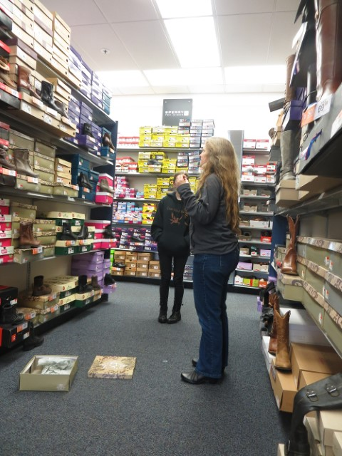 Buying shoes in a slanky but slightly redneck store
