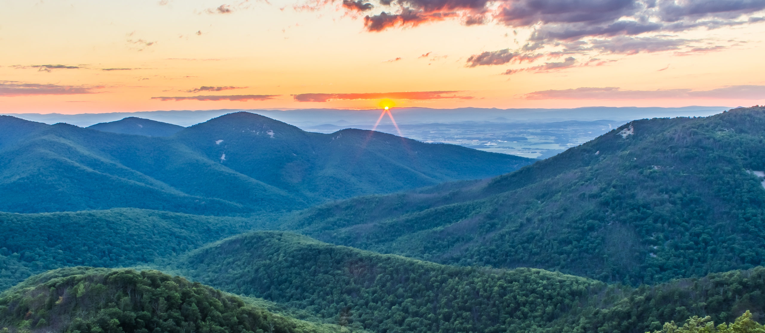 A sunset with clouds as seen from Skyline Drive of Shenandoah National