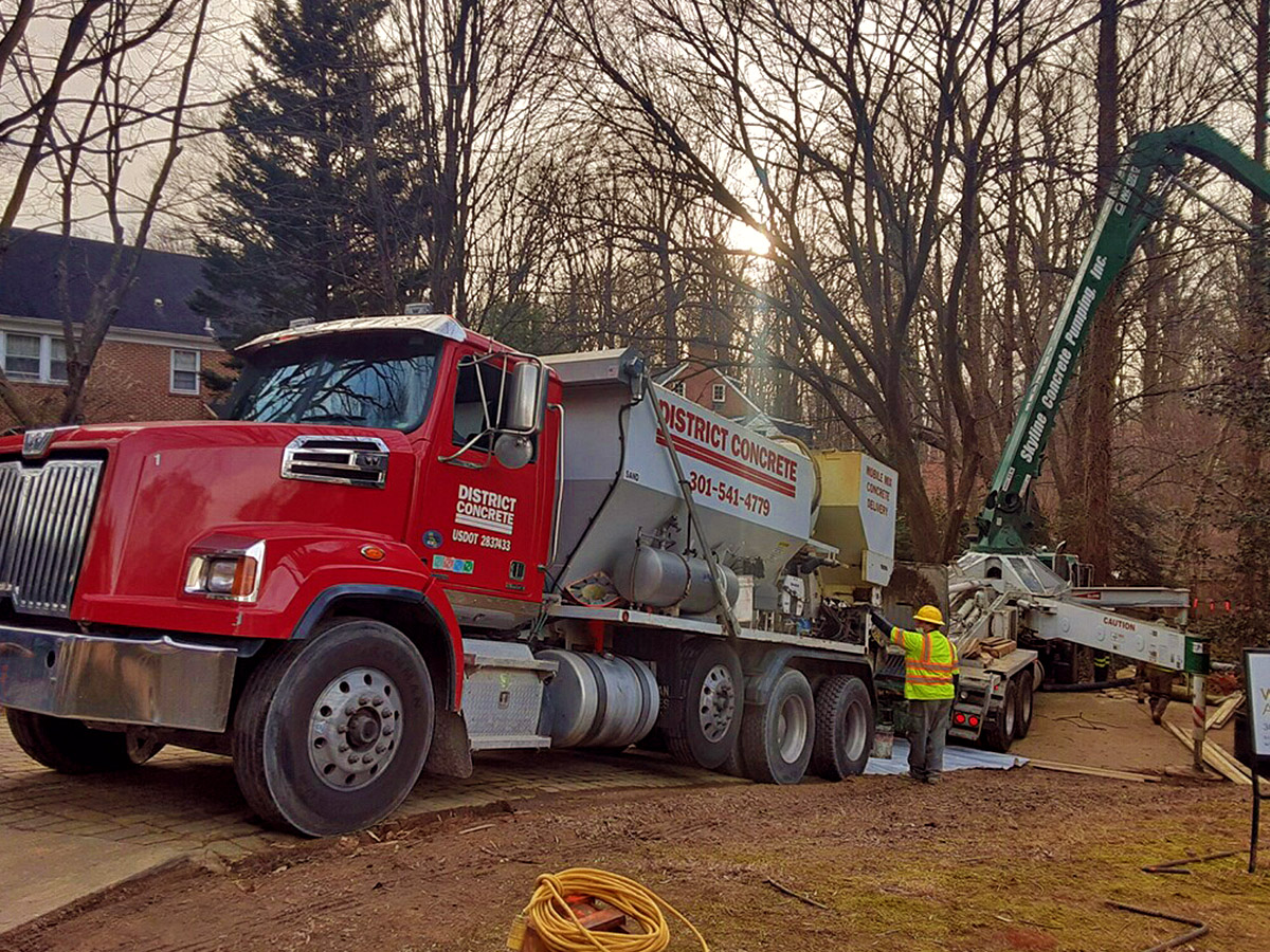 district concrete truck pouring cement