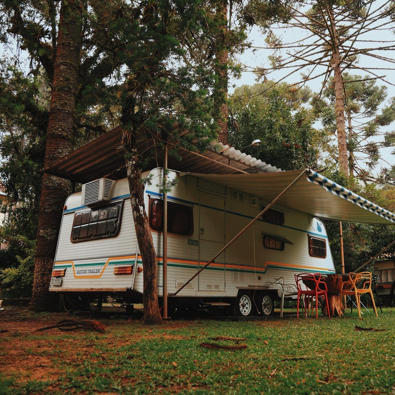 rv-with-tent-under-a-tree