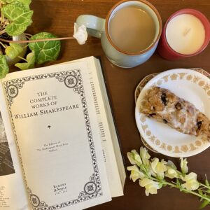 Book on table with coffee and pastry