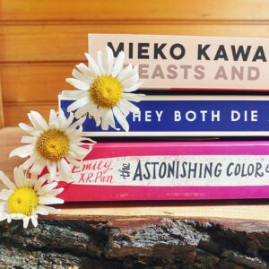 Stack of Books with Daisies