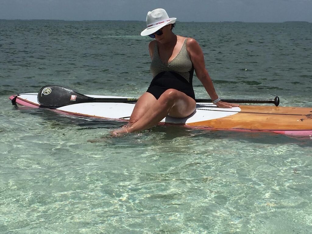enjoy paddle boarding in your sailing charter