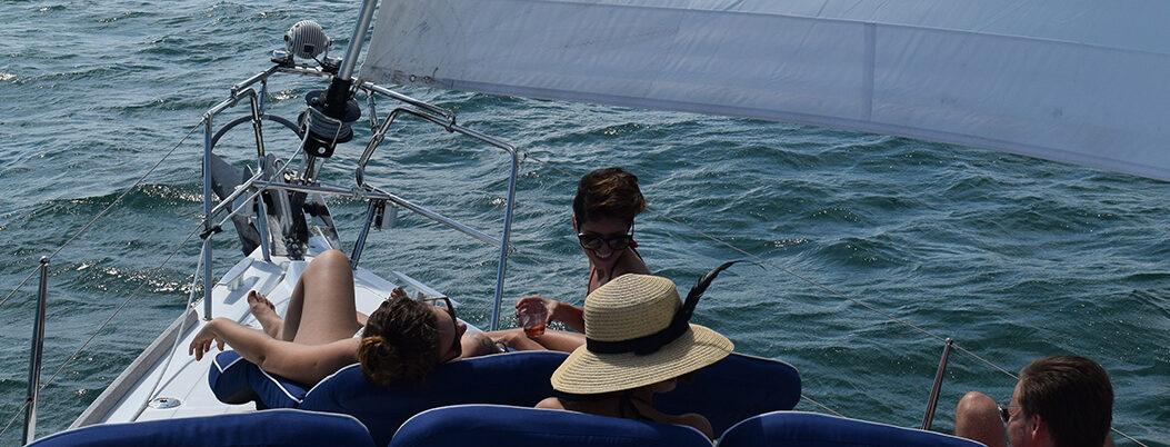 Young people enjoying a sailing charter