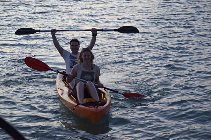 Couple from sailing to kayak