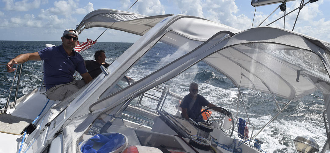 AT HELM IN A HIGH PERFORMANCE SAILING
