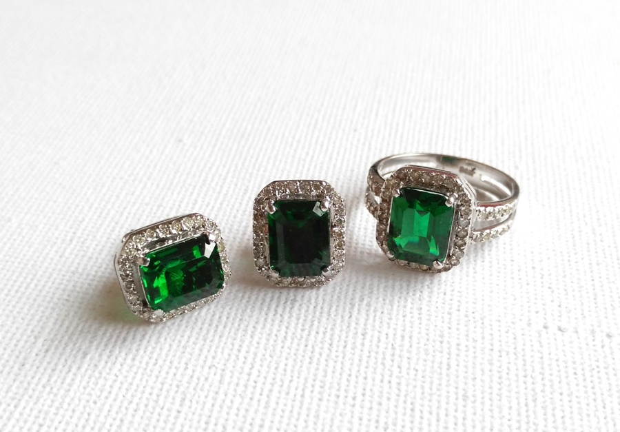 The beautifully designed emerald ring comes with matching pair of earrings. Inquire for price at dbrightspot@gmail.com.