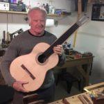 Guitarist Gordon Kreplin in a luthier's shop