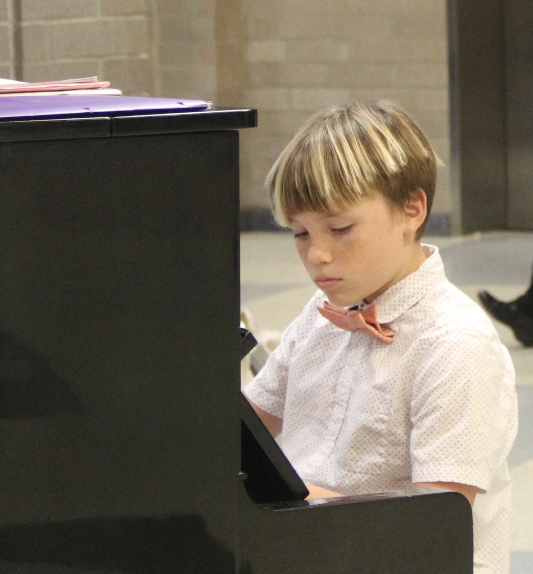 Student Concerts in 2020. Young boy plays jazz piano in ragtime concert.