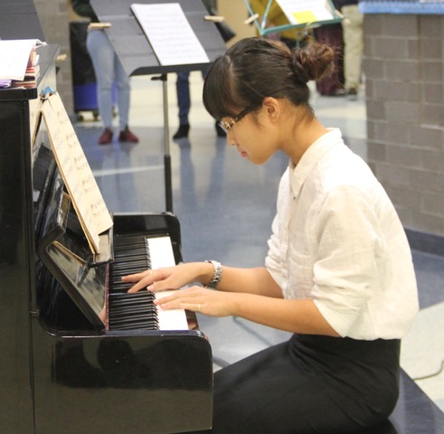 Student Concerts in 2020 - live. Young woman playing piano.