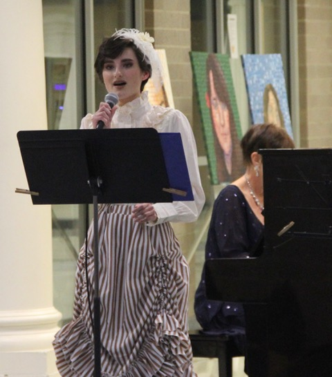 Student concerts in 2020. Young woman singing ragtime song in live concert.