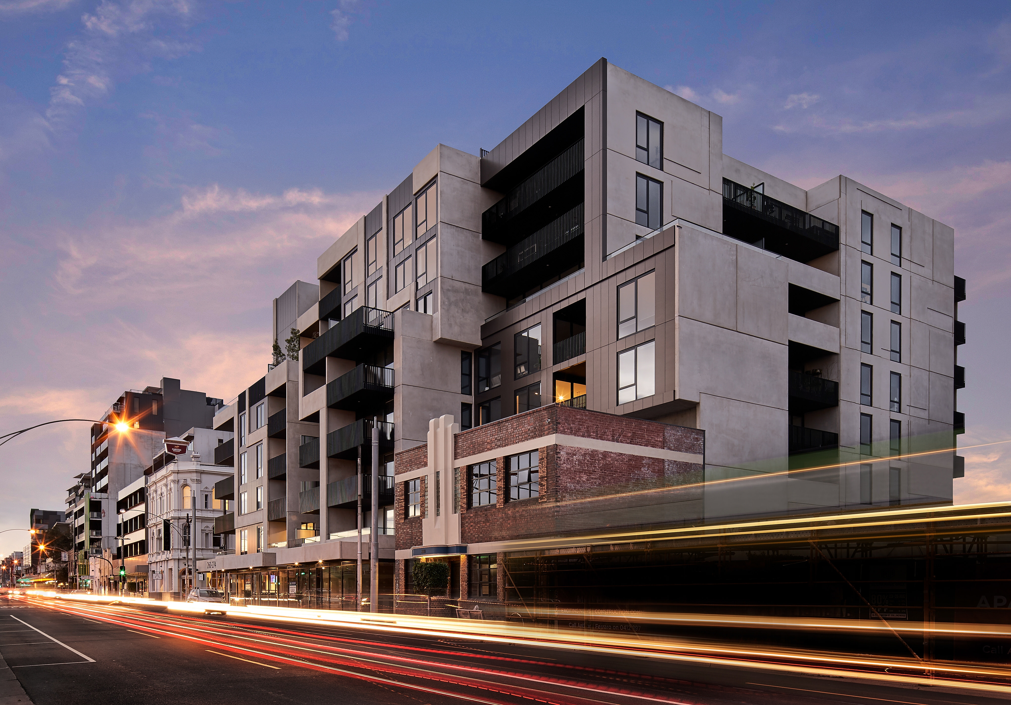 Concrete architect designed apartment building with integrated with heritage listed victorian brick building on Lygon Street in Melbourne.
