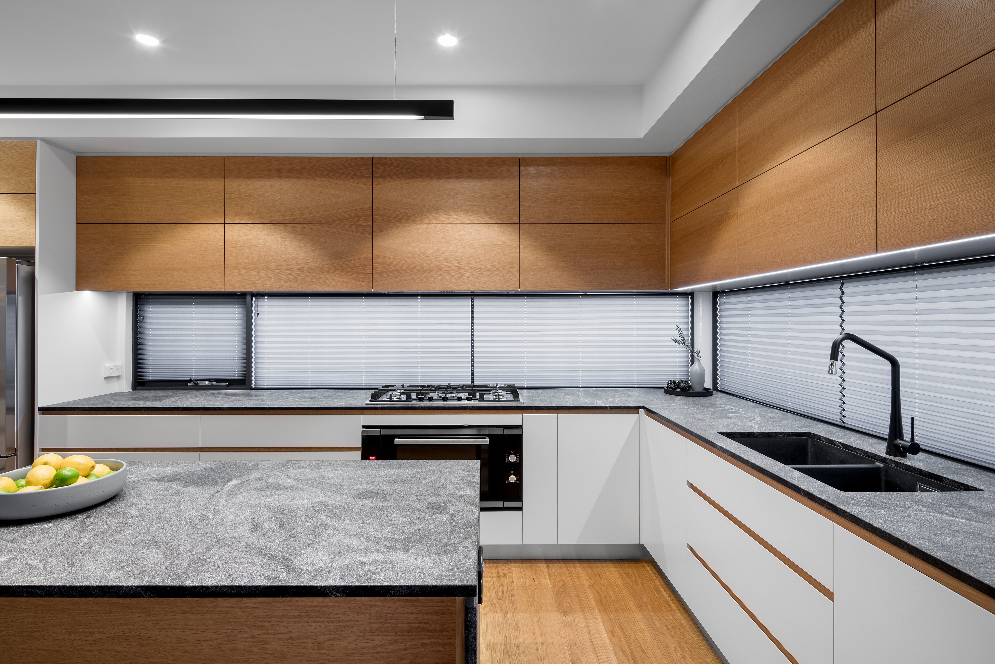 minimal kitchen design with white draws and timber accents