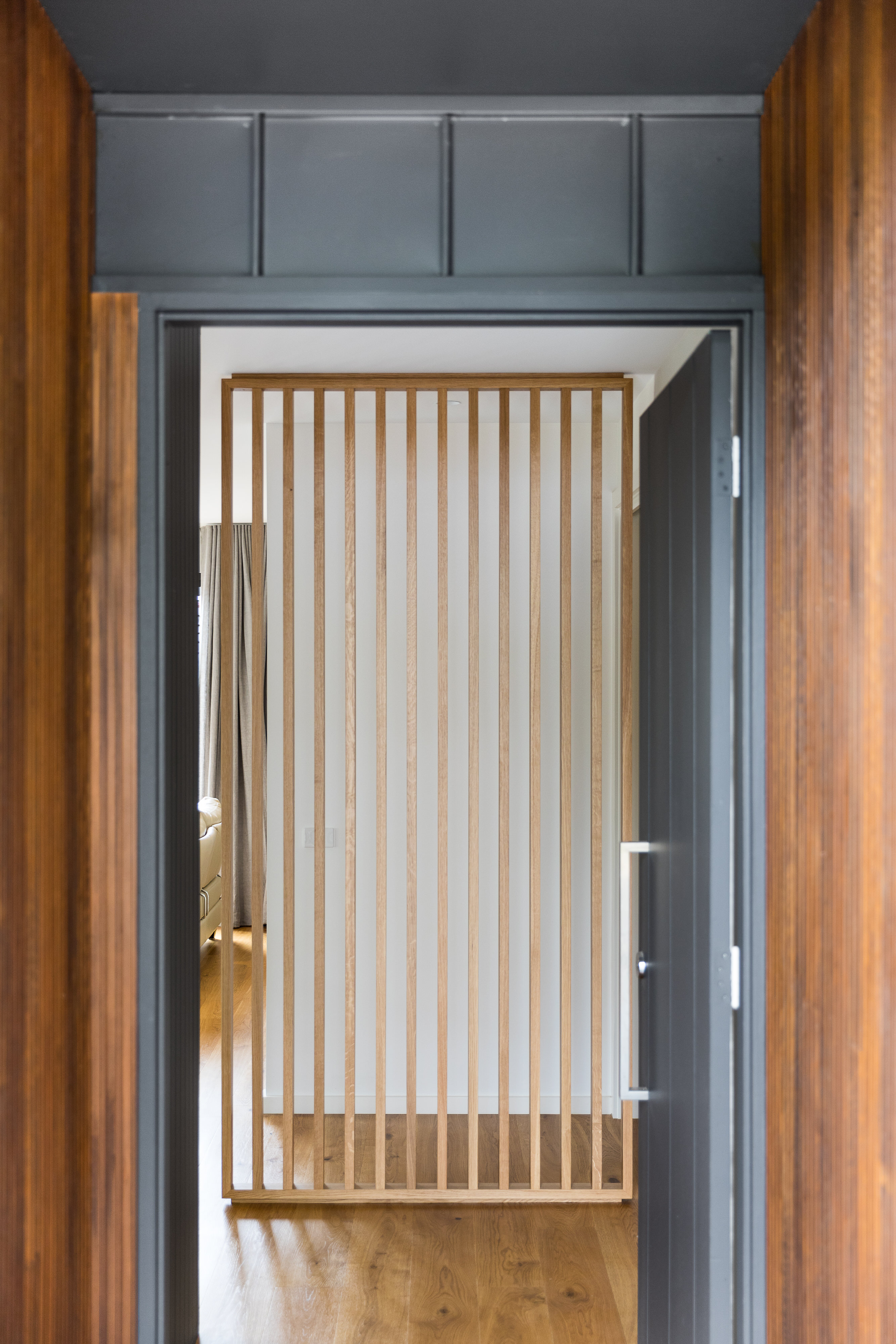 Open front door view featuring slat timber screen