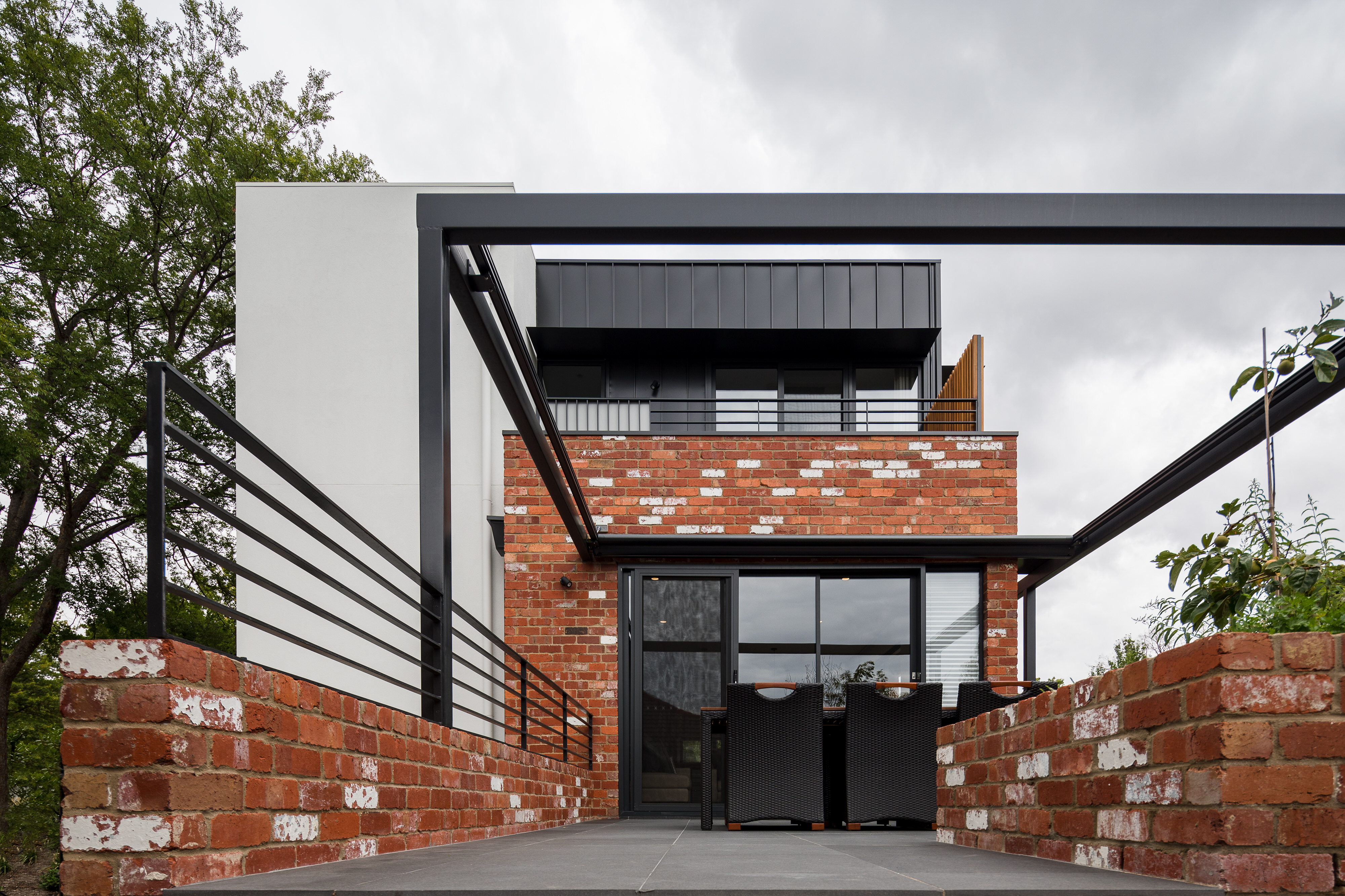Deck area of modern architect designed home featuring recycled bricks