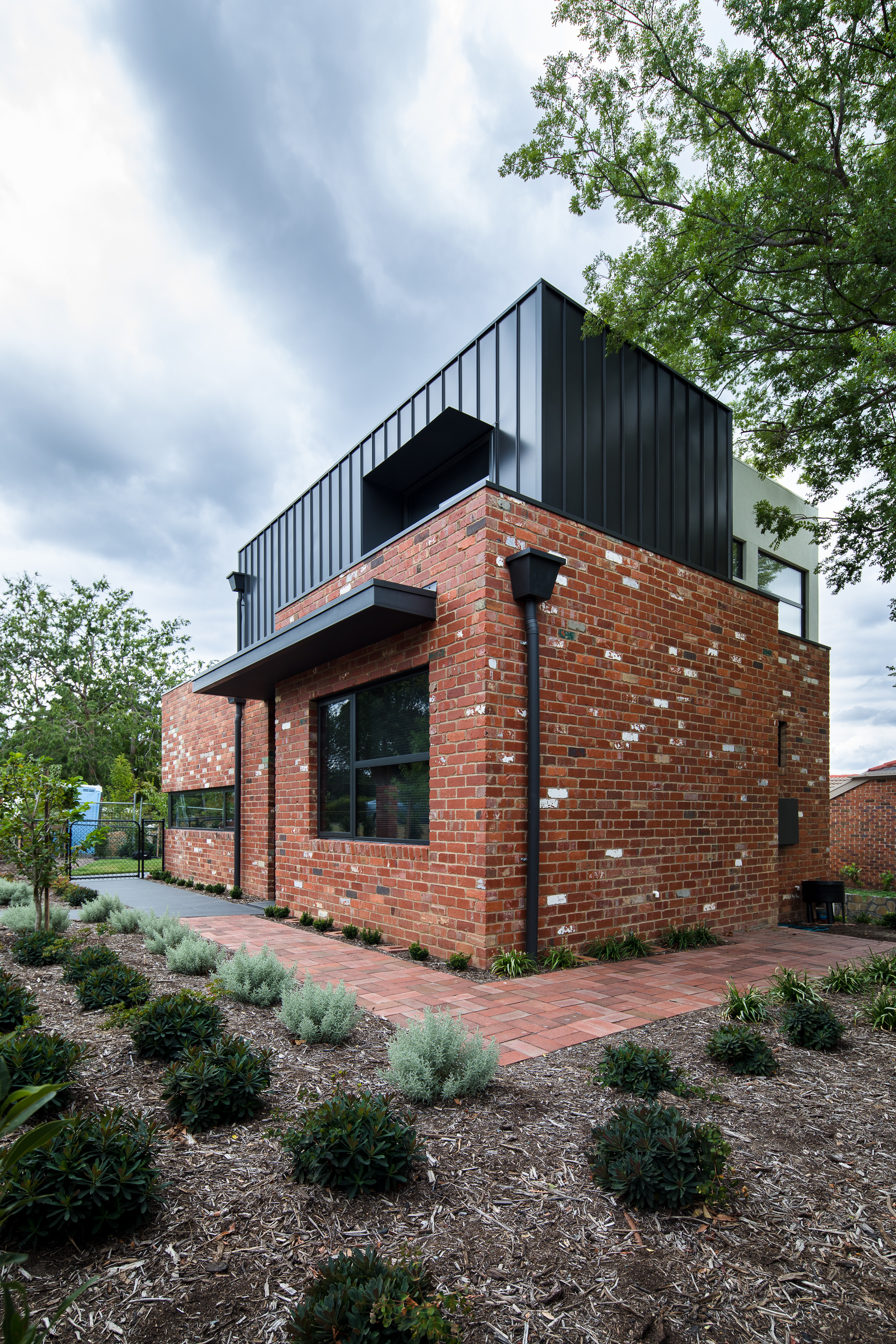 Box house design using recycled bricks in Australia