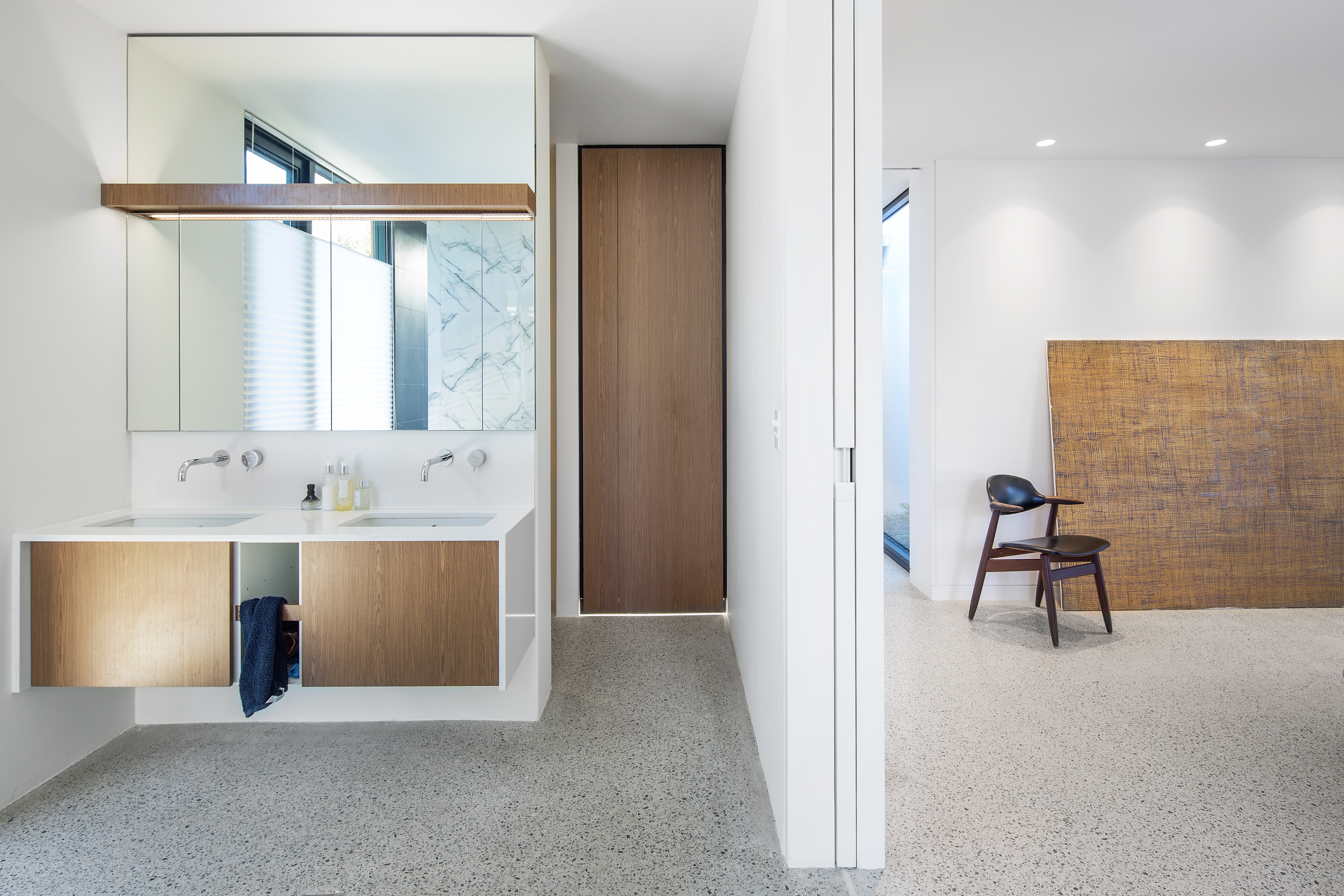 stunning ensuite done in minimal approach with white and timber doors