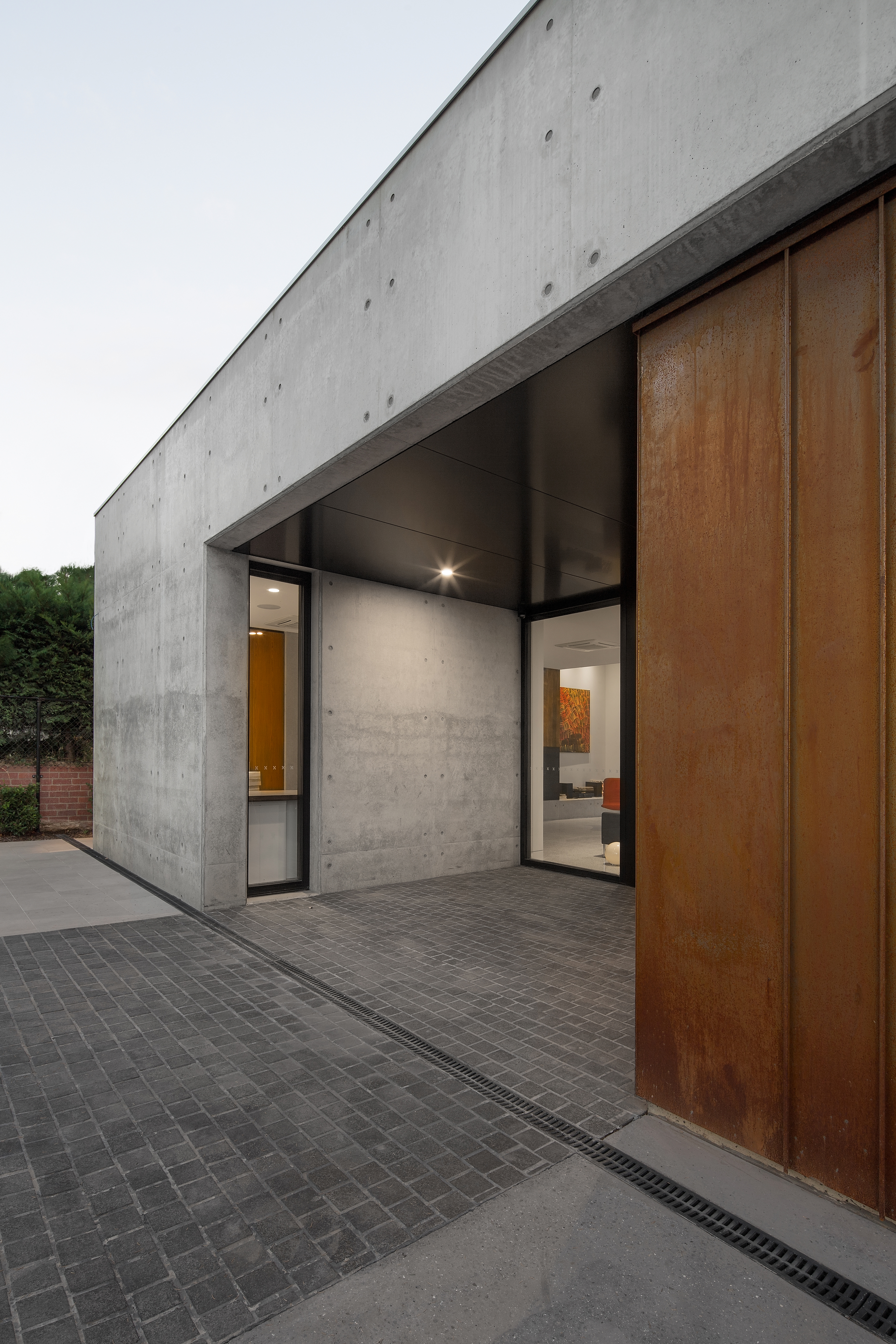 minimal architect designed entryway with copper cladding