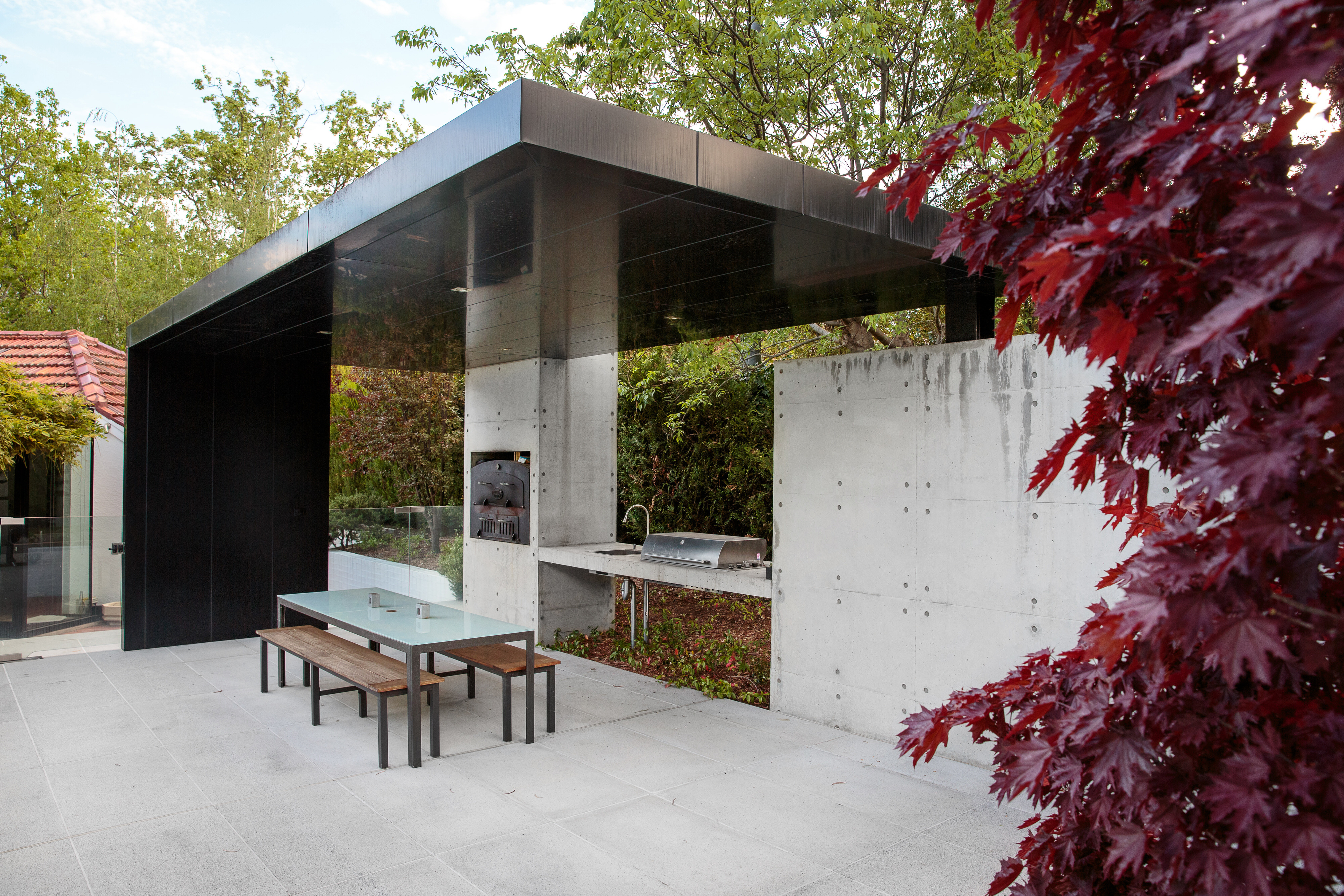 Swimming pool and outdoor dining area constructed in off form concrete