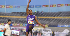 Wayne Pinnock of Kingston College in long jump